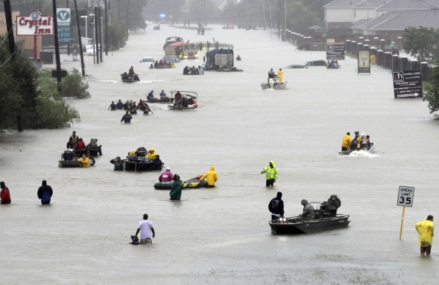 Flood evacuees Rescue boats fill a flooded street at flood victims are evacuated as floodwaters from Tropical Storm Harvey rise, in HoustonHarvey, Houston, USA - 28 Aug 2017
