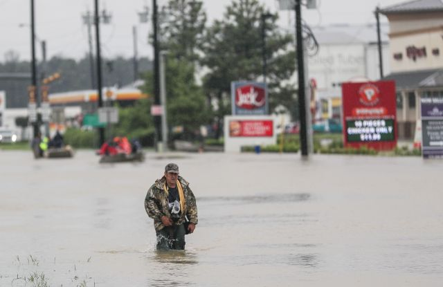 A man walks through floodwaters in the aftermath of Hurricane Harvey in Houston, Texas, USA, 29 August 2017. Hurricane Harvey made landfall on the south coast of Texas as a major hurricane category 4. The last time a major hurricane of this size hit the United States was in 2005.Hurricane Harvey aftermath, Houston, USA - 29 Aug 2017