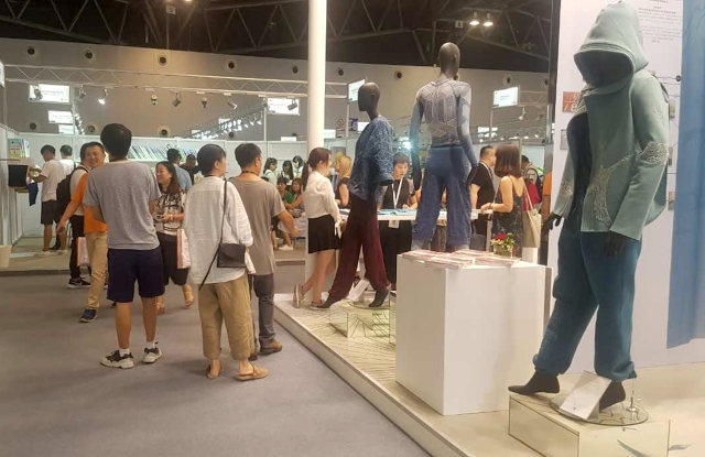 Visitors check out the trends at Spinexpo Shanghai