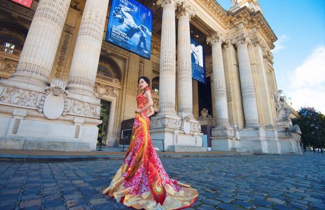 Anna Hu at La Biennale in a Guo Pei dress.