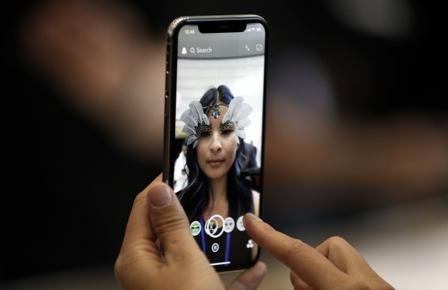 The new iPhone X is displayed in the showroom after the new product announcement at the Steve Jobs Theater on the new Apple campus, in Cupertino, CalifApple Showcase, Cupertino, USA - 12 Sep 2017