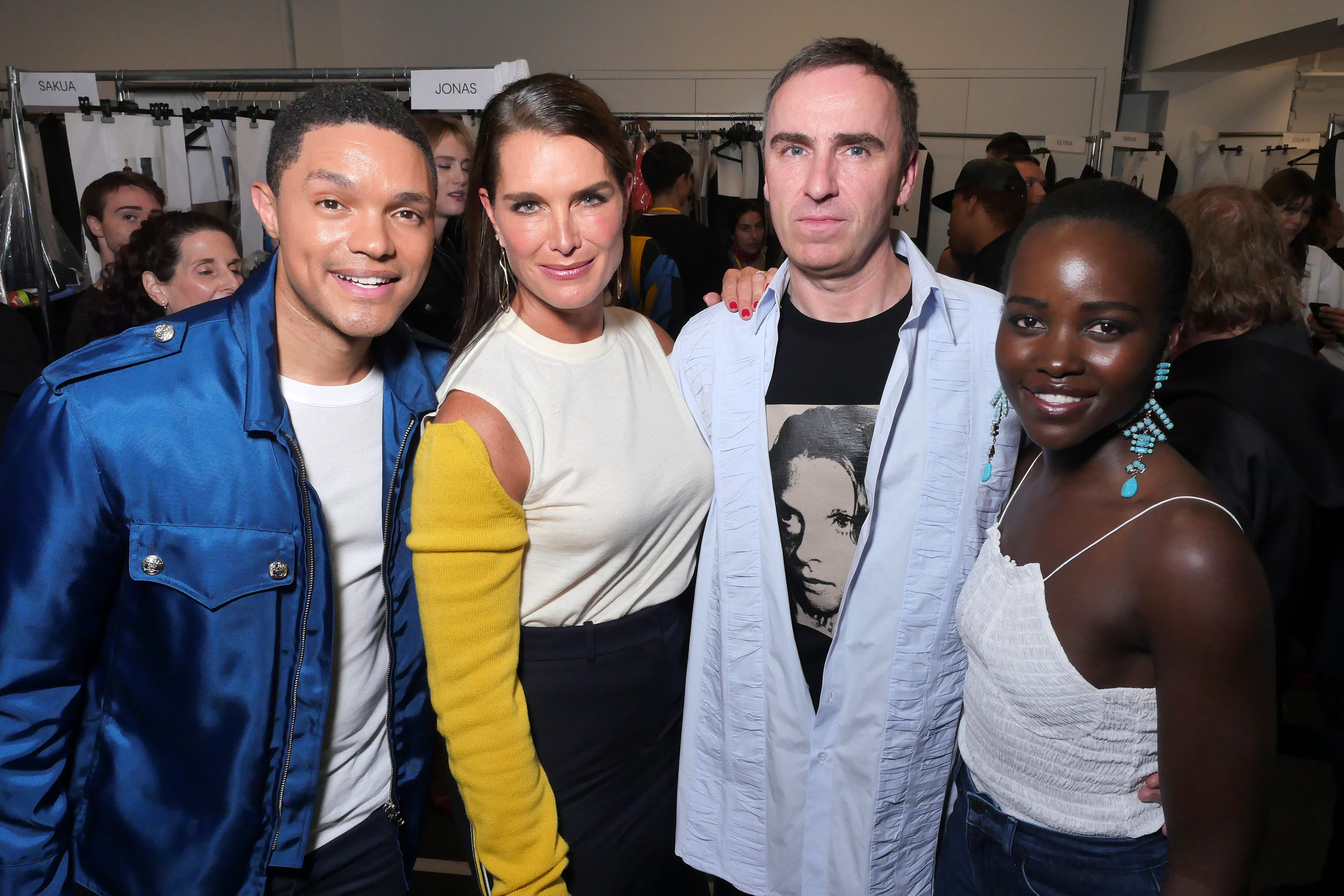Trevor Noah, Brooke Shields, Raf Simons and Lupita Nyong'o in the Front Row at Calvin Klein 205W39NYC RTW Spring 2018