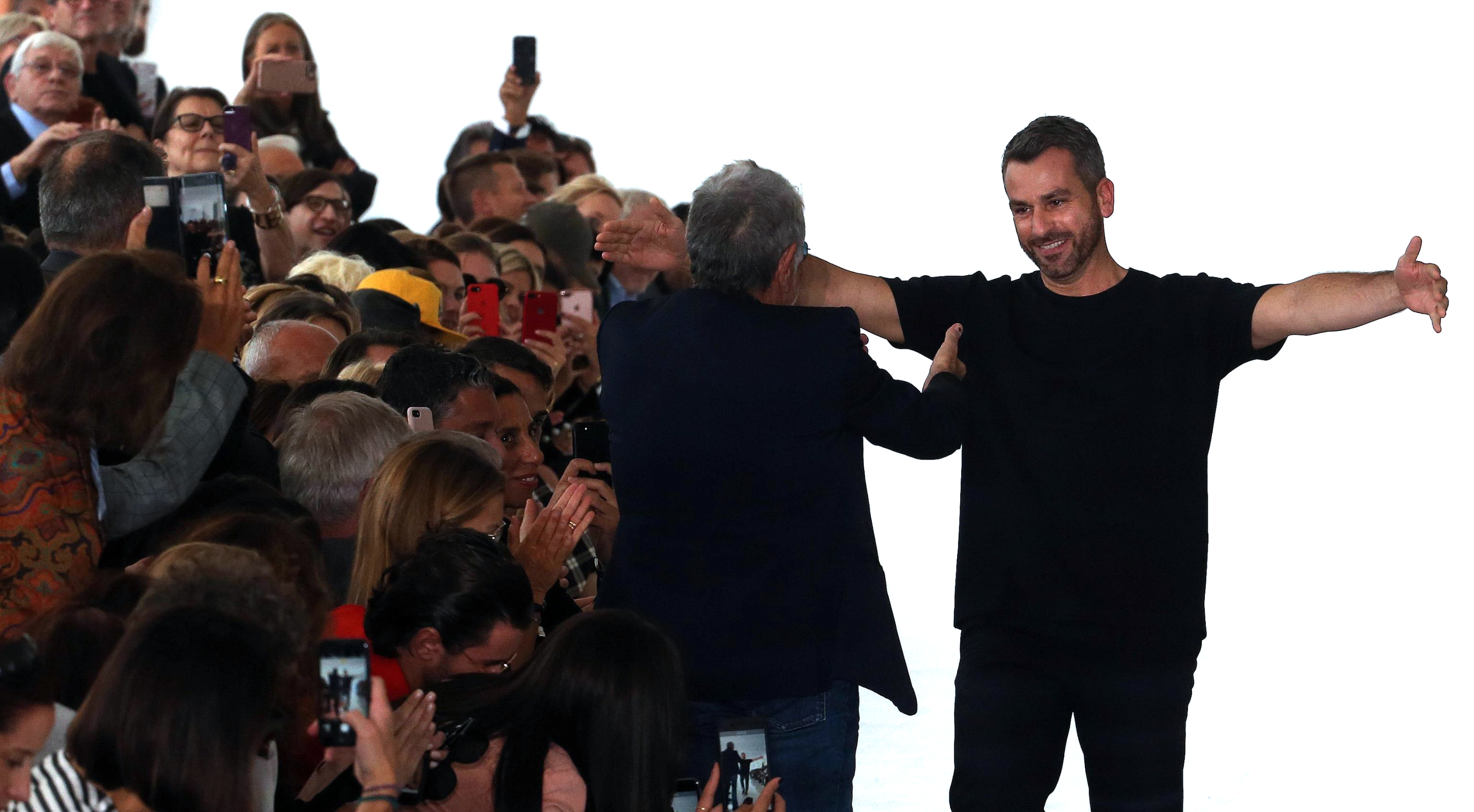 Paul SurridgeRoberto Cavalli - Runway - Milan Fashion Week, Italy - 22 Sep 2017British designer Paul Surridge (R) greets members of the audience after the presentation of his collection for Roberto Cavalli during the Milan Fashion Week, in Milan, Italy, 22 September 2017. The Spring-Summer 2017/2018 collections are presented at the Milano Moda Donna from 20 to 25 September.