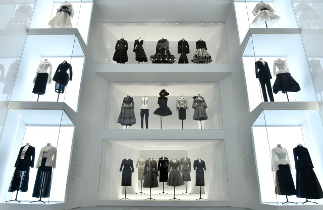 Vintage Dior designs sit alongside outfits by contemporary brands like Thom Browne, Comme des Garçons and Givenchy in the Dior exhibition at Les Arts Décoratifs.