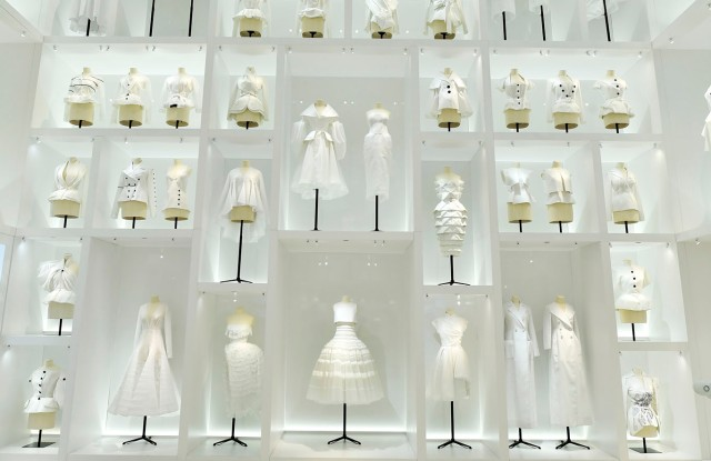 A room full of toiles evokes the haute couture atelier in the Dior exhibition at Les Arts Décoratifs.