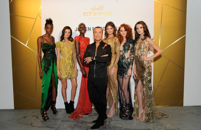 NEW YORK, NY - SEPTEMBER 07:  Vice President of Sponsorships Etihad Airways Patrick Pierce, Fashion designer Julien Macdonald (C) and models attend Etihad Airways Celebrating Runway To Runway With Special Guest Julien MacDonald Obe at Skylight Clarkson Sq on September 7, 2017 in New York City.  (Photo by Rabbani and Solimene Photography/Getty Images for IMG Fashion)