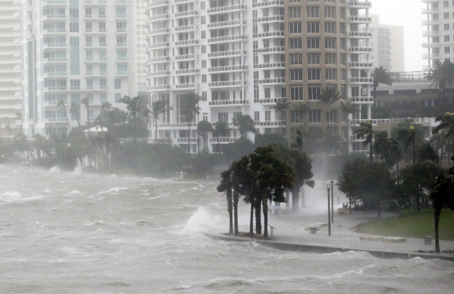 Waves crash over a seawall at the mouth of the Miami River from Biscayne Bay, Fla., as Hurricane Irma passes by, in MiamiHurricane Irma, Miami, USA - 10 Sep 2017