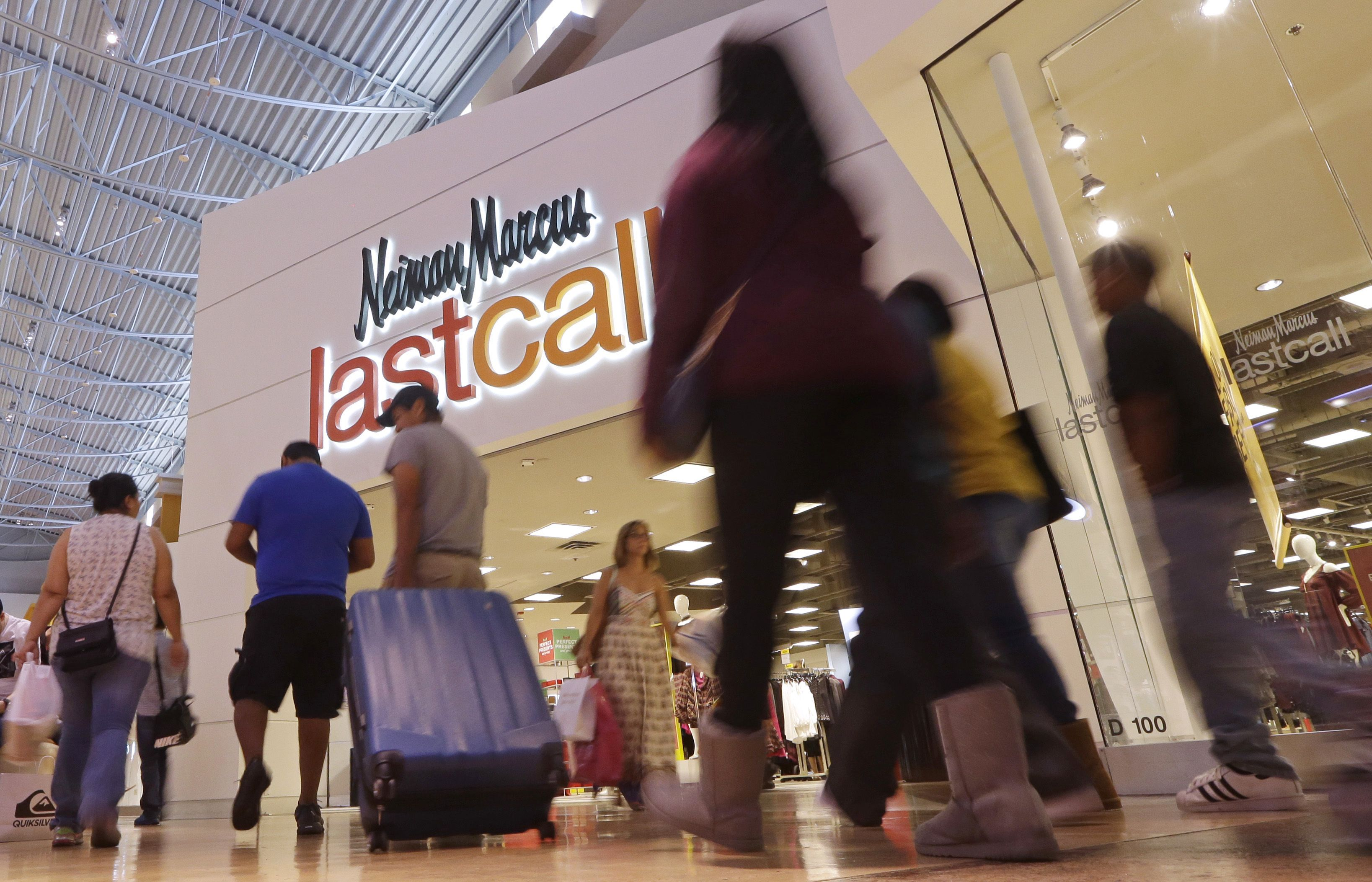 Shoppers walk by a Neiman Marcus department store on Black Friday in Miami, . Stores open their doors Friday for what is still one of the busiest days of the year, even as the start of the holiday season edges ever earlierHoliday Shopping Black Friday, Miami, USA - 25 Nov 2016