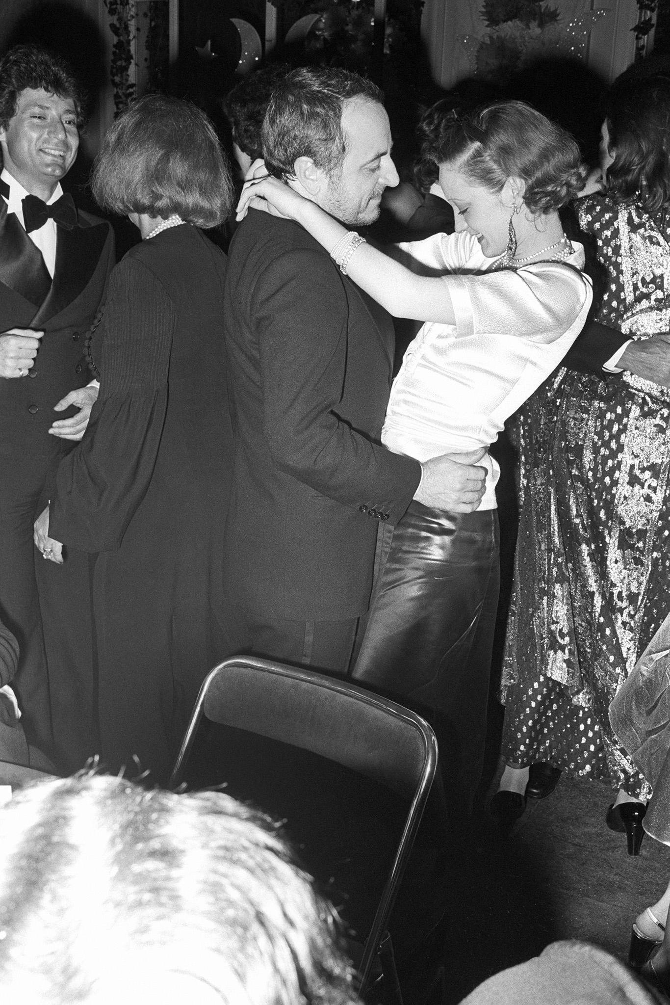 Loulou de La Falaise and Pierre BergŽ dance at a party in Paris for The Paris Party People.