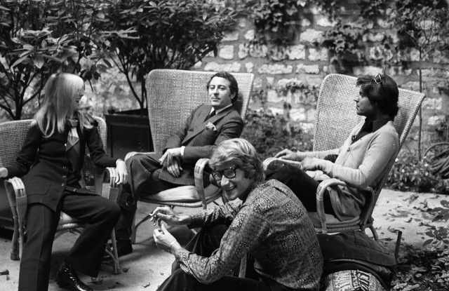 Designer Yves Saint Laurent with partner Pierre Bergé, Betty Catroux and her husband Francois Catroux in the graden of Yves Saint Laurent's Paris home.