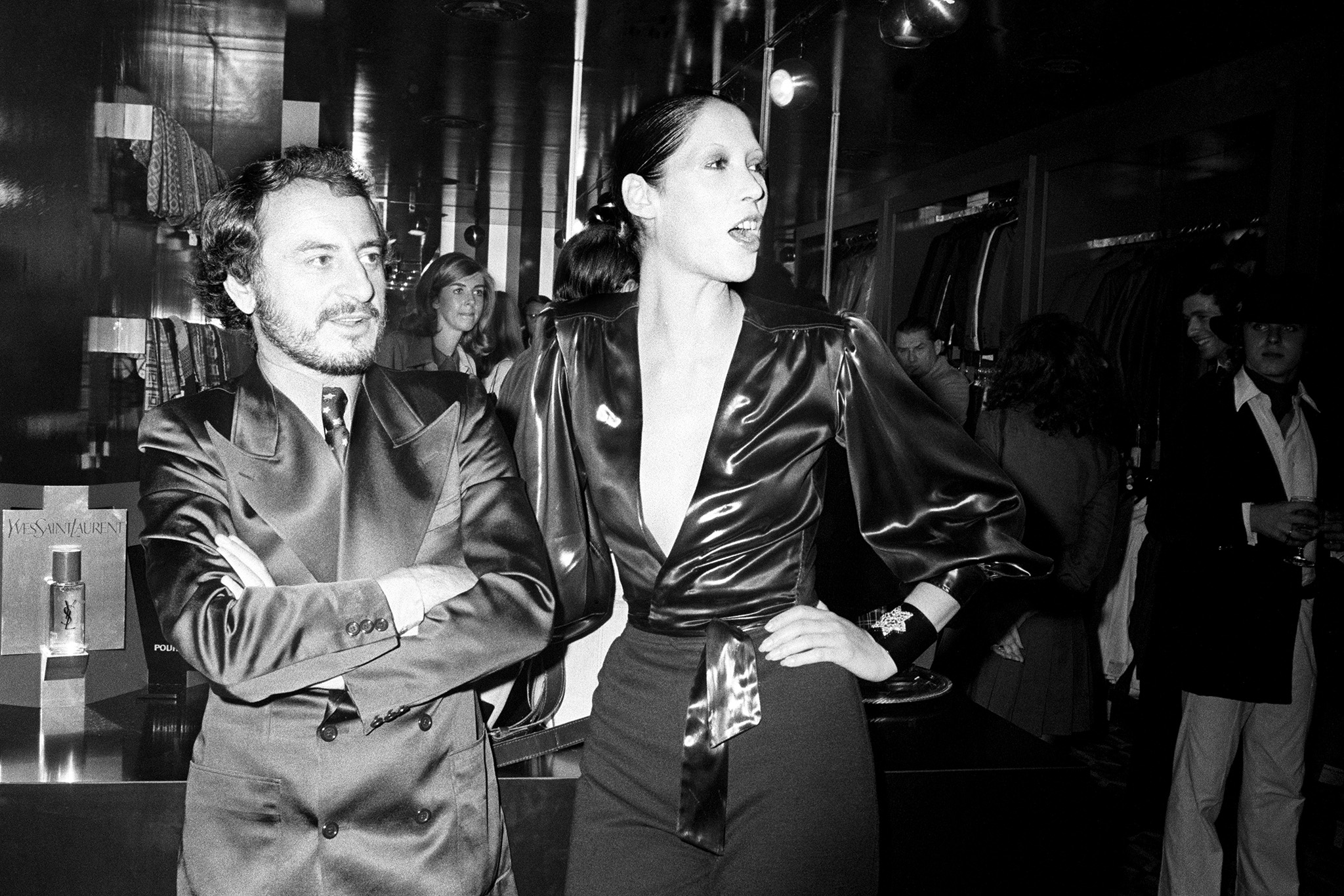 Pierre Berge and Marina Schiano attending the Yves St. Laurent Rive Gauche Boutique pour Homme opening on October 6, 1971 in New York.