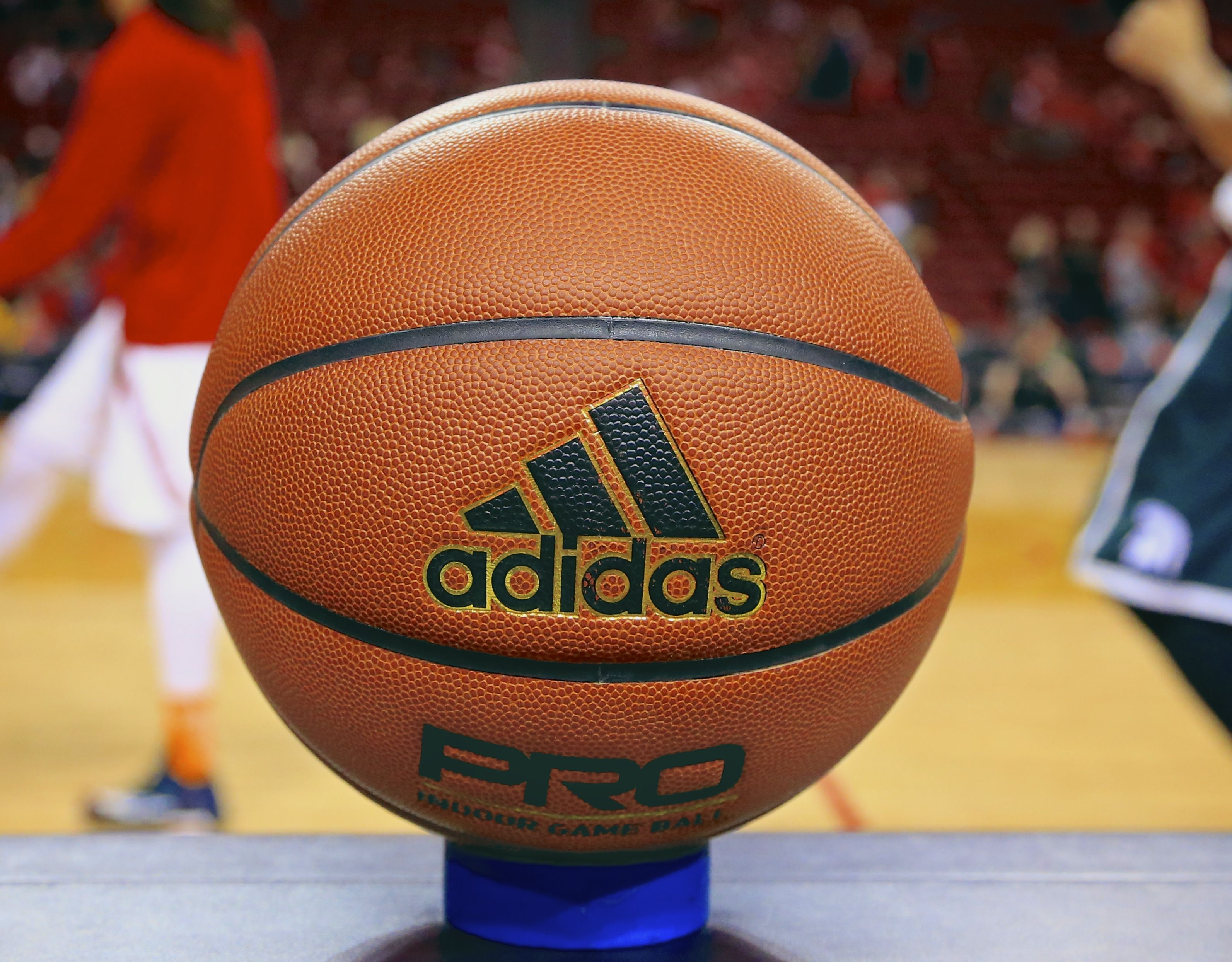 Photo, an Adidas game ball rests on the scorer's table prior to an NCAA college basketball game between Michigan State and Nebraska in Lincoln, Neb. Unlike the NBA, which uses the Spalding ball for all games, the NCAA has no uniform brand for regular-season games. That means a team could be playing with a type of ball it's unaccustomed to when it goes on the roadGame Balls Galore Basketball, Lincoln, USA