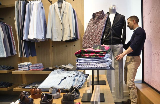 Bonobos manager Stephen Lusardi arranges clothing at the brand's Guideshop, in New York's Financial District. More shoppers are looking to social media or curated selections for fashion inspiration. That adds to the woes of mall-based stores, as people are already buying fewer clothes, spending online or at discounters when they do, and demanding more personal and convenient ways to buyShopping for Clothes, New York, USA - 20 Mar 2017