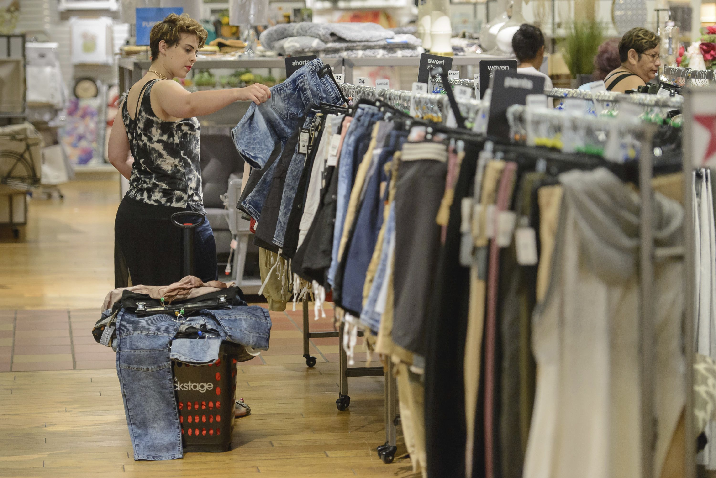 Copyright 2017 The Associated Press. All rights reserved. This material may not be published, broadcast, rewritten or redistributed without permission.Mandatory Credit: Photo by AP/REX/Shutterstock (8871393a)Carley Davis from Flint, Michigan does some shopping during Macy's Backstage grand opening at the Fairlane Town Center, in Dearborn, Mich. Macy's is opening Macy's Backstage stores, within a store, across the country designed for the savvy and cost conscious shopperMacy's Backstage Fairlane Town Center Grand Opening, Dearborn, USA - 17 Jun 2017