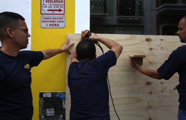 Men cover the entrance of a room with wooden boards in San Juan, Puerto Rico, 5 September 2017. Puerto Rico is taking measures ahead of the passage of Hurricane Irma, which is on the verge of impacting the Caribbean Lesser Antilles as it reached the maximum level of category 5.Puerto Rico takes measures ahead of Irma's Hurricane passsage, San Juan - 05 Sep 2017