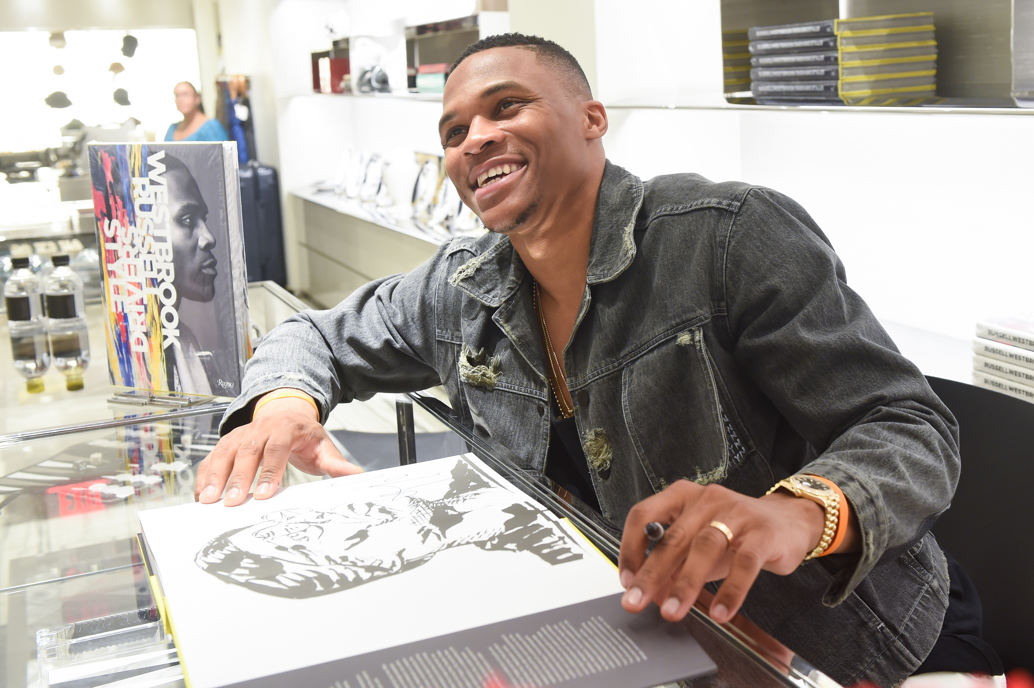 Russell Westbrook signs his new book during an event at Barneys.