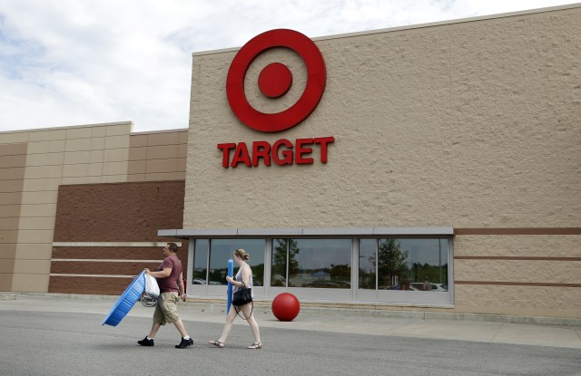 Customers walk with their purchases from a Target store, in Methuen, Mass. Target Corp. reports earnings, Wednesday, Aug. 16, 2017Earns Target, Methuen, USA - 27 Jun 2016