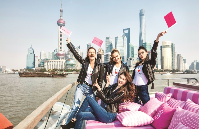 Victoria's Secret angels pose in front of the Shanghai skyline.
