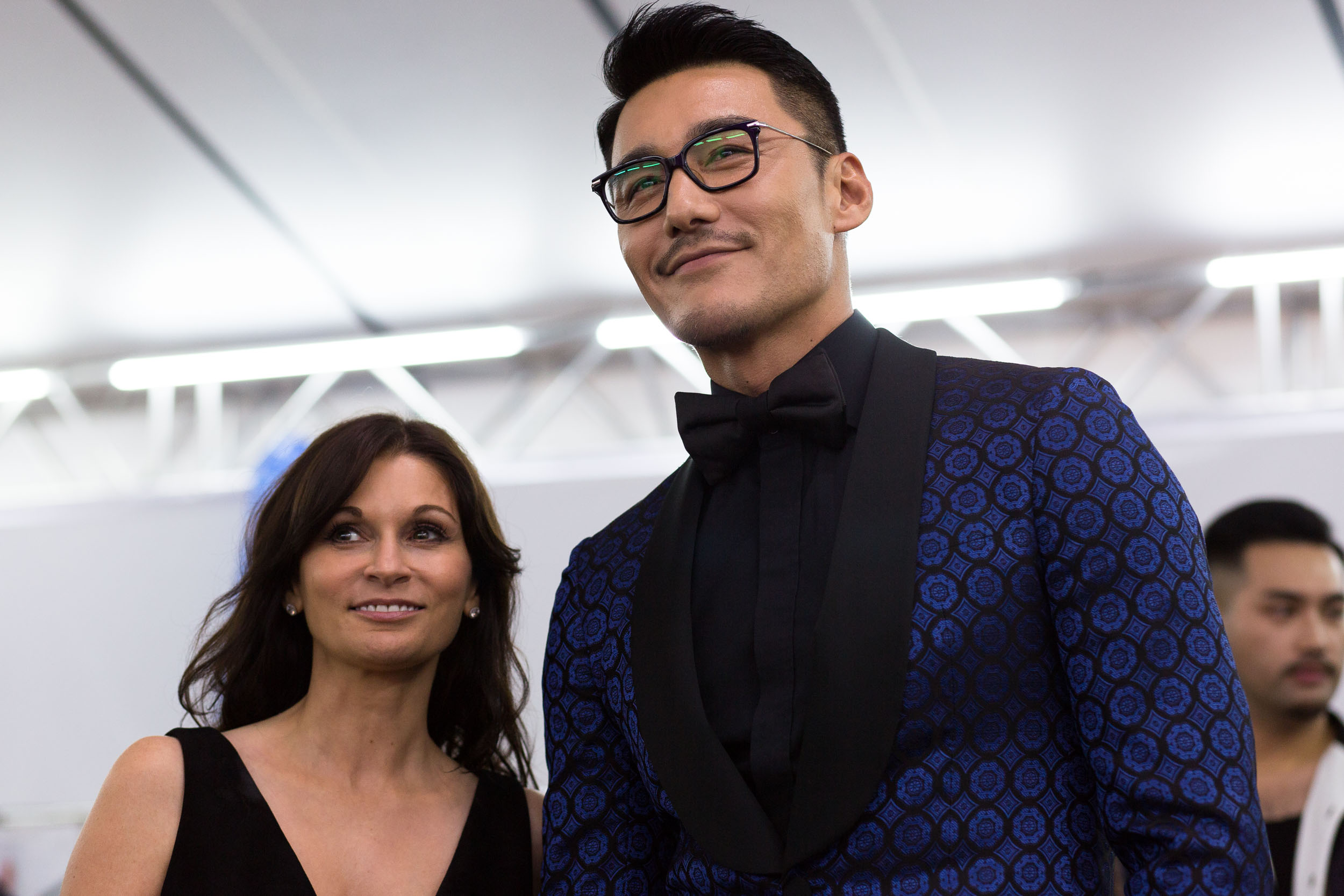 La Perla designer Julia Haart (left) and Chinese actor Hu Bing (right) backstage before the show.