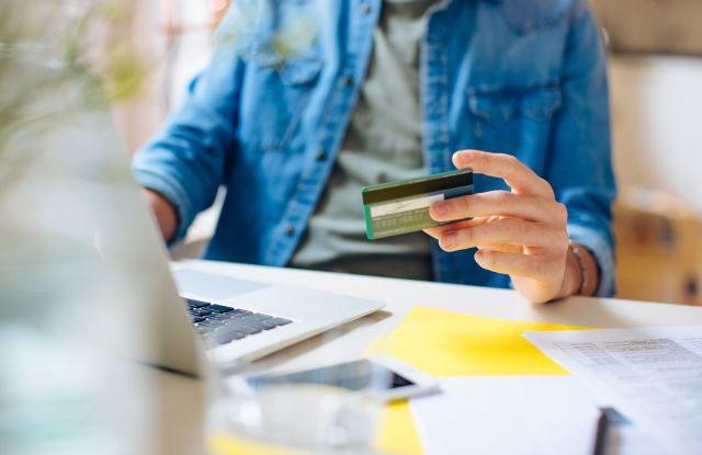 Online spending is expected to surpass in-store shopping this holiday, according to a Deloitte survey.
