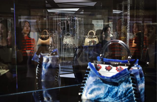 Luxury handbags on display in Beijing. Around 8 percent of Chinese luxury purchases are made online.