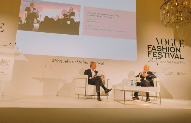 Kering's François-Henri Pinault talks with Condé Nast France ceo Xavier Romatet at the Vogue Fashion Festival.