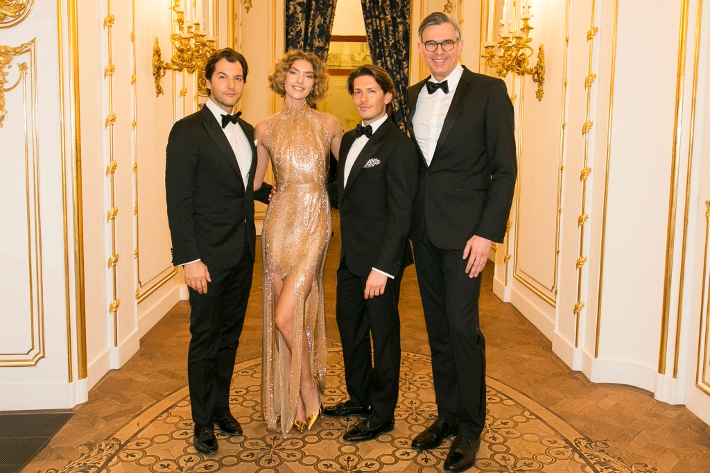 Aquazzura's co-founder Ricardo D'Almeida Figueiredo, model Arizona Muse, Aquazurra's co-founder and creative director Edgardo Osorio and Mytheresa.com president Michael Kliger at the Aquazurra x Mytheresa.com Woman in Gold party in Wien, Austria.