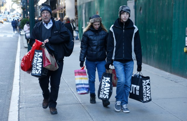 Holiday shoppers coming from Uniqlo.