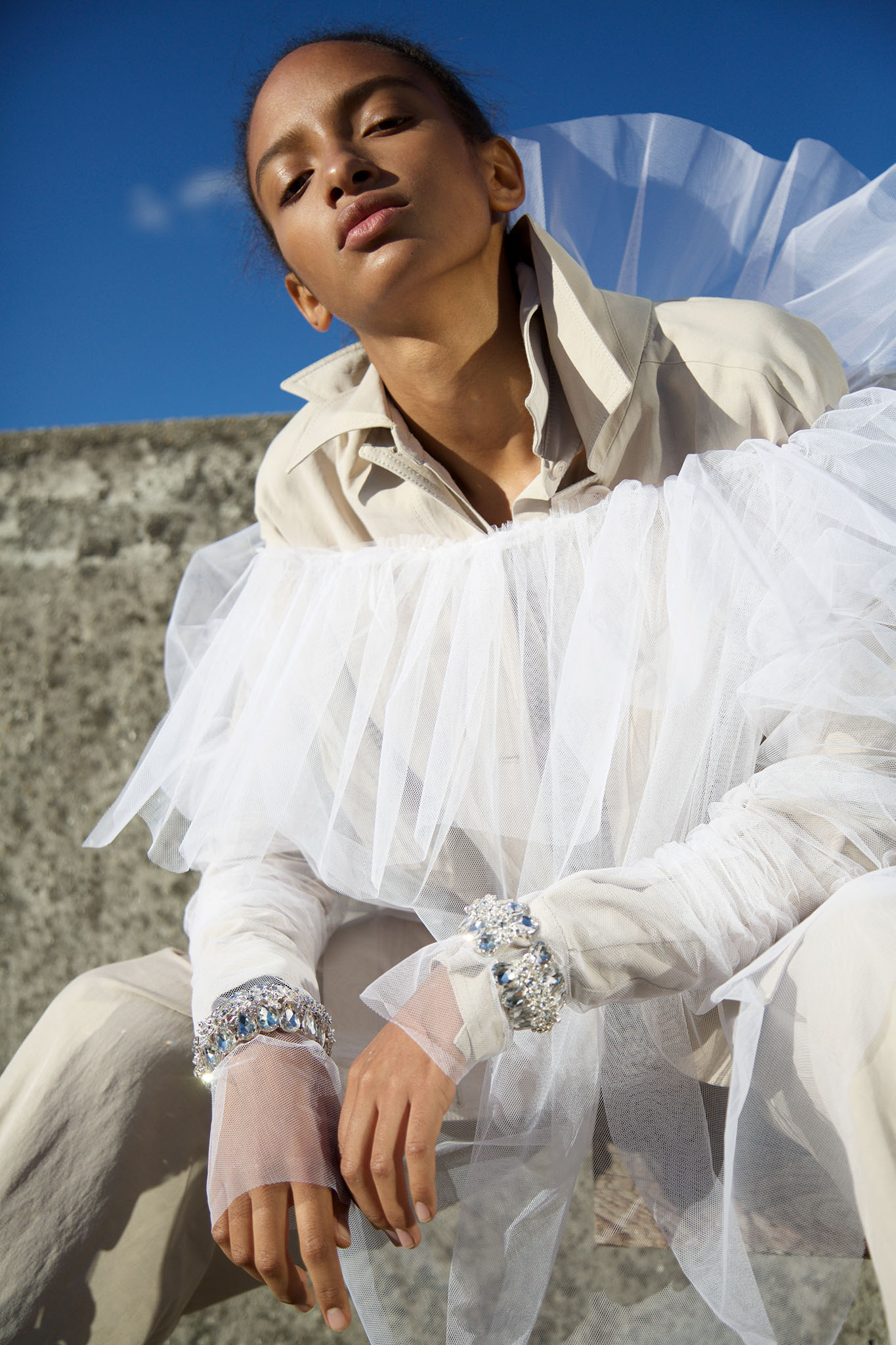 Stella McCartney cotton shirt and trousers, Emanuel Ungaro tulle top and Nicopanda cuffs.