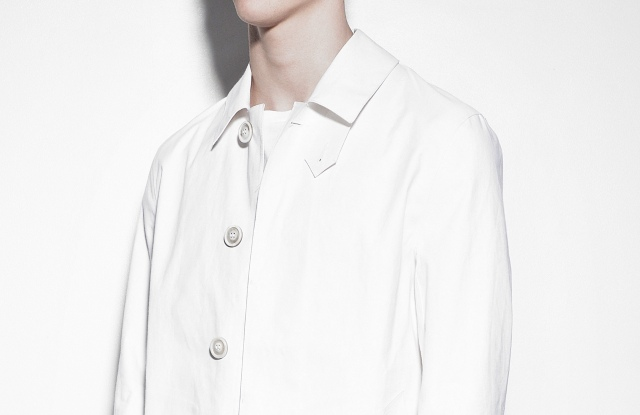 A white trench coat from Maison Margiela's collaboration with Mackintosh.