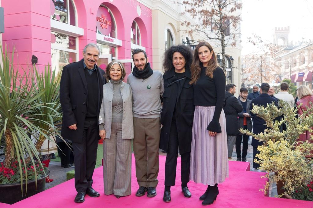 Italy's Fashion Chamber president Carlo Capasa, Desirée Bollier, Tiziano Guardini, Vogue Italia's Sara Sozzani Maino and Livia Firth in front of The Creative Spot Fashion in Fidenza Village, Italy.