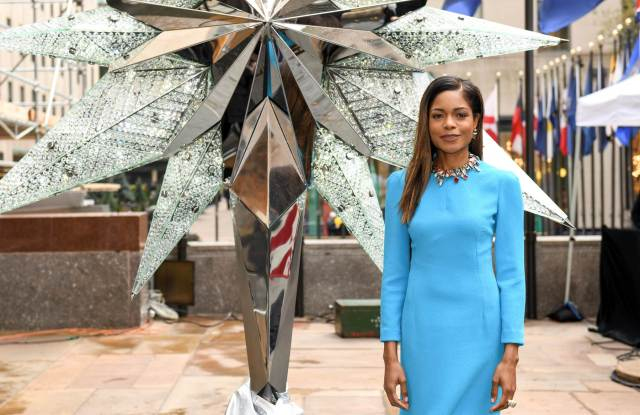 Naomie Harris poses for a photo before the Swarovski Star is raised to the top of the Rockefeller Center Christmas Tree, in New York.
