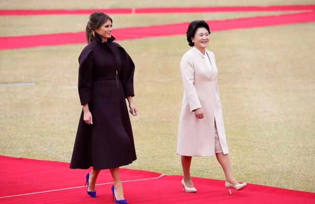 US First Lady Melania Trump (L) and South Korean First Lady Kim Jung-Sook (R) walk during a welcoming ceremony held at the presidential Blue House in Seoul, South Korea, 07 November 2017. Trump is on a two-day official visit to South Korea, the second stop on his 12 day tour of Asia.US President Donald J. Trump visits South Korea, Seoul - 07 Nov 2017