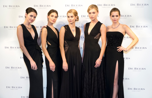 Models wearing the new Lotus By De Beers high jewellery collection