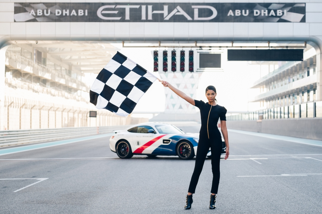 IMG Model Chanel Iman models the new Grid Girl uniform at the F1 race track at Yas Marina Circuit in front of a Mercedes AMG GTS