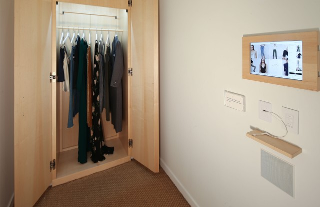 """The store features touch screens that send apparel directly to dressing rooms and digital fitting room """"attendees"""" for ordering additional styles or sizes. Its """"magic wardrobes,"""" or two-way doors, allow for product fulfillment without leaving fitting rooms."""