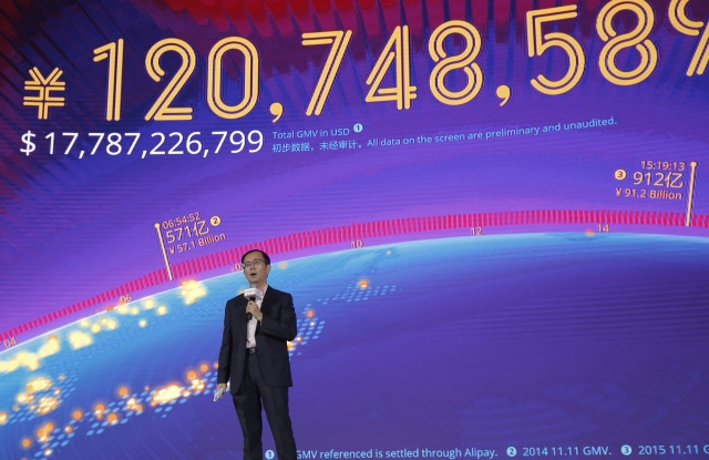 """Daniel Zhan Daniel Zhang, CEO of Alibaba Group speaks in front of a giant screen showing a total sales transacted of e-commerce giant Alibaba, on the """"Singles' Day"""" global online shopping festival in Shenzhen, southern China's Guangdong province . In a bright spot for China's cooling economy, online shoppers spent billions of dollars Friday on """"Singles' Day,"""" a quirky holiday that has grown into the world's busiest day for e-commerceChina Singles' Day, Shenzhen, China - 11 Nov 2016"""