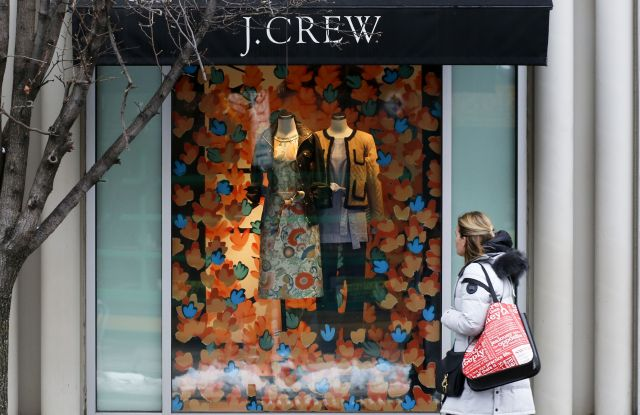 Hold for Swayne Hall Business Photo-A shopper passes the display in the window of a J.Crew store in the Shadyside shopping district of PittsburghConsumer Spending, Pittsburgh, USA - 10 Feb 2017