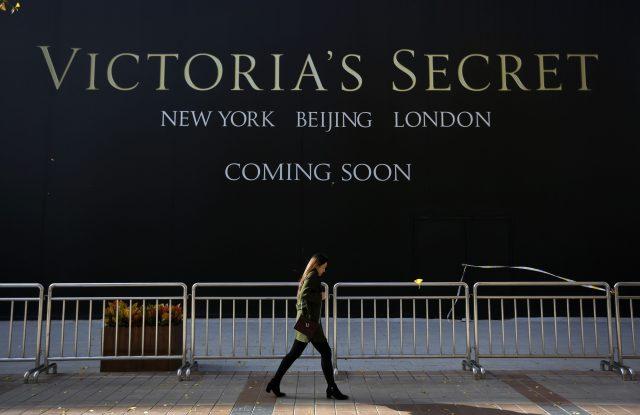 A Chinese woman walks past a Victoria's Secret store under construction in Wangfujing, Beijing.