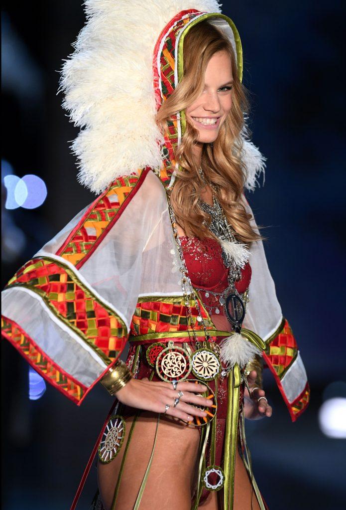 Nadine Leopold wears a headdress in the Victoria's Secret Fashion Show 2017.