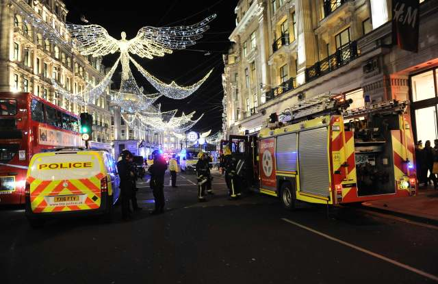Armed police at Oxford Circus conducting an evacuation after a police incident at Oxford Circus