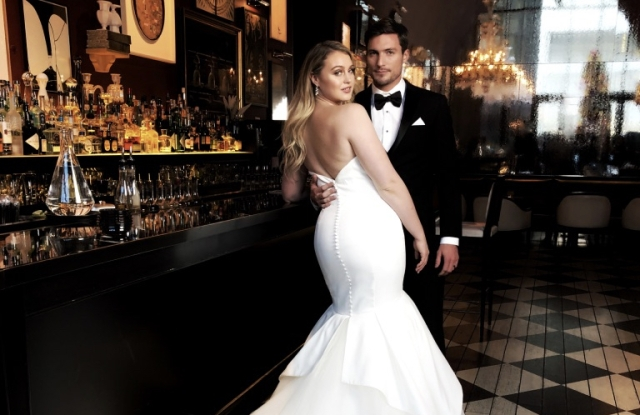 Iskra Lawrence modeling for Justin Alexander at the Baccarat Hotel.
