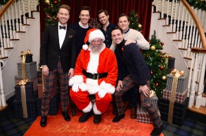 Christopher Hanke, Erich Bergen, Andrew Rannells, Michael Doyle, and Max von Essen pose with Santa.