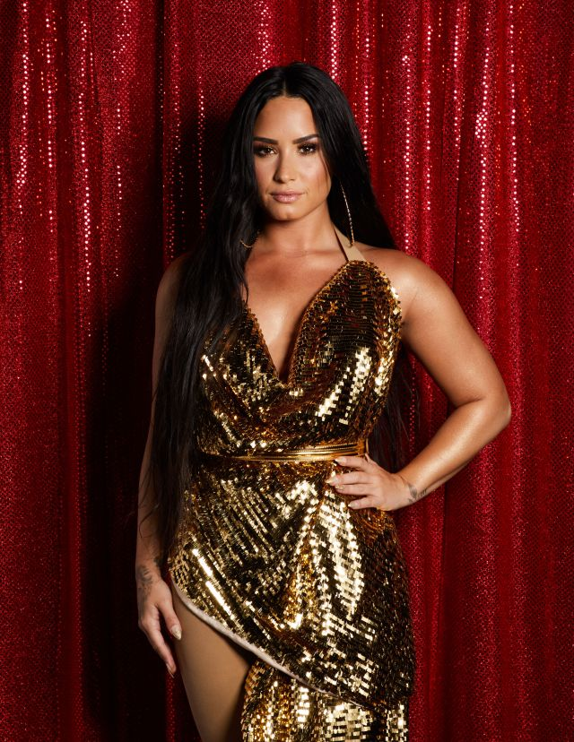 Demi Lovato gold jumpsuit jingle ball