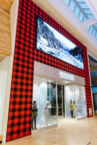The exterior is covered in Woolrich's signature Buffalo Plaid.