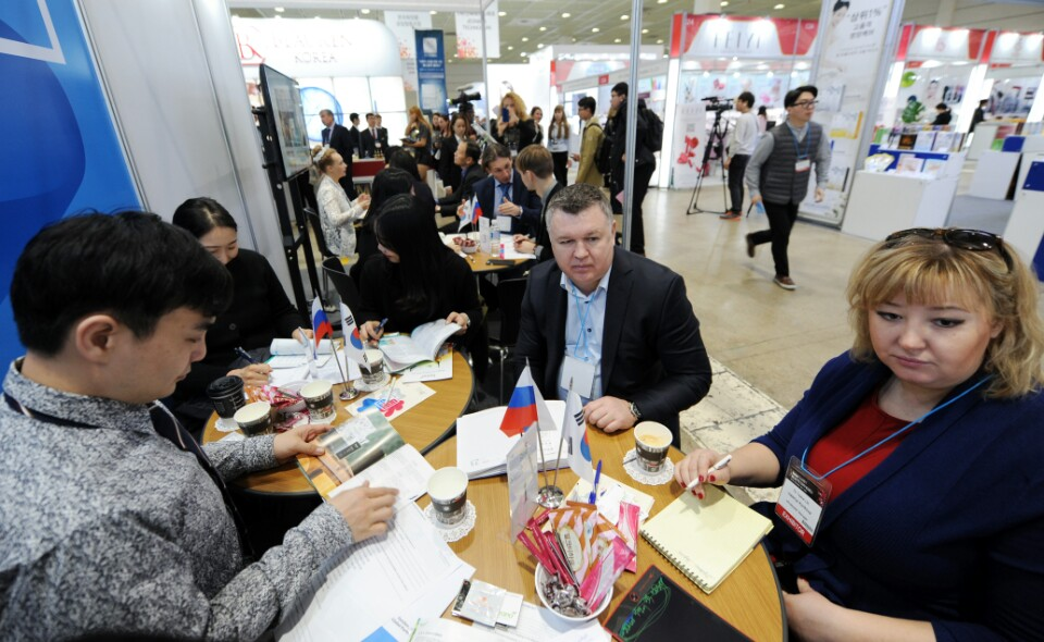 Buyers visit a booth at the Intercharm Beauty Expo Korea show in Seoul.