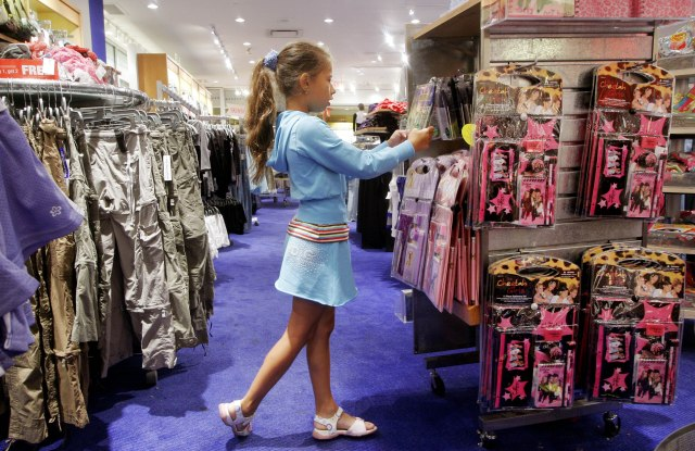 A young girl shops for back-to-school items at Limited Too in 2006.