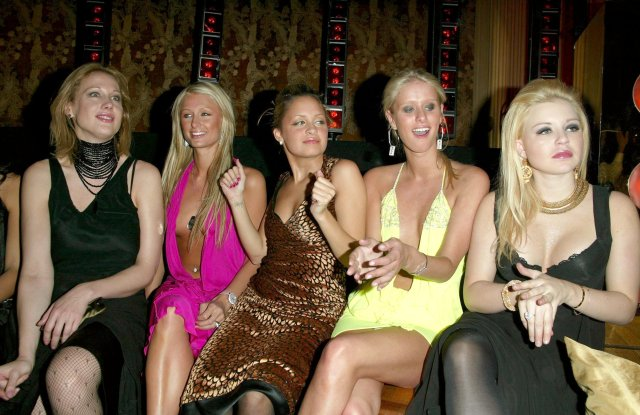 Amy Sacco, Paris Hilton, Nicole Richie, Nicky Hilton and Casey Johnson attend a party in 2003, dressed in typical early-Aughts fashion.