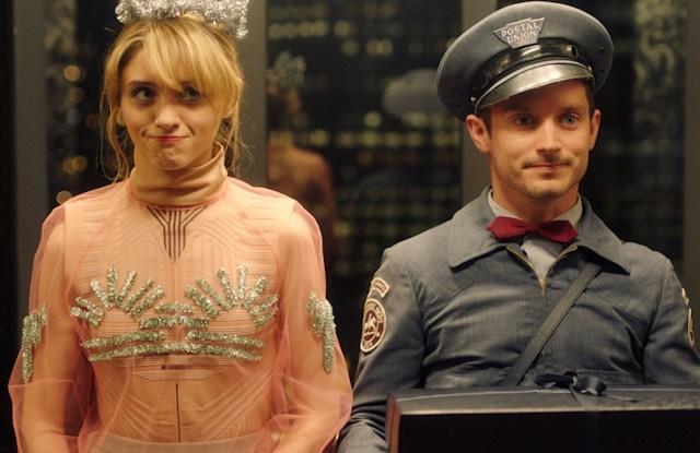 "Natalia Dyer and Elijah Wood in Prada's ""The Postman Dreams 2"" short movies series."