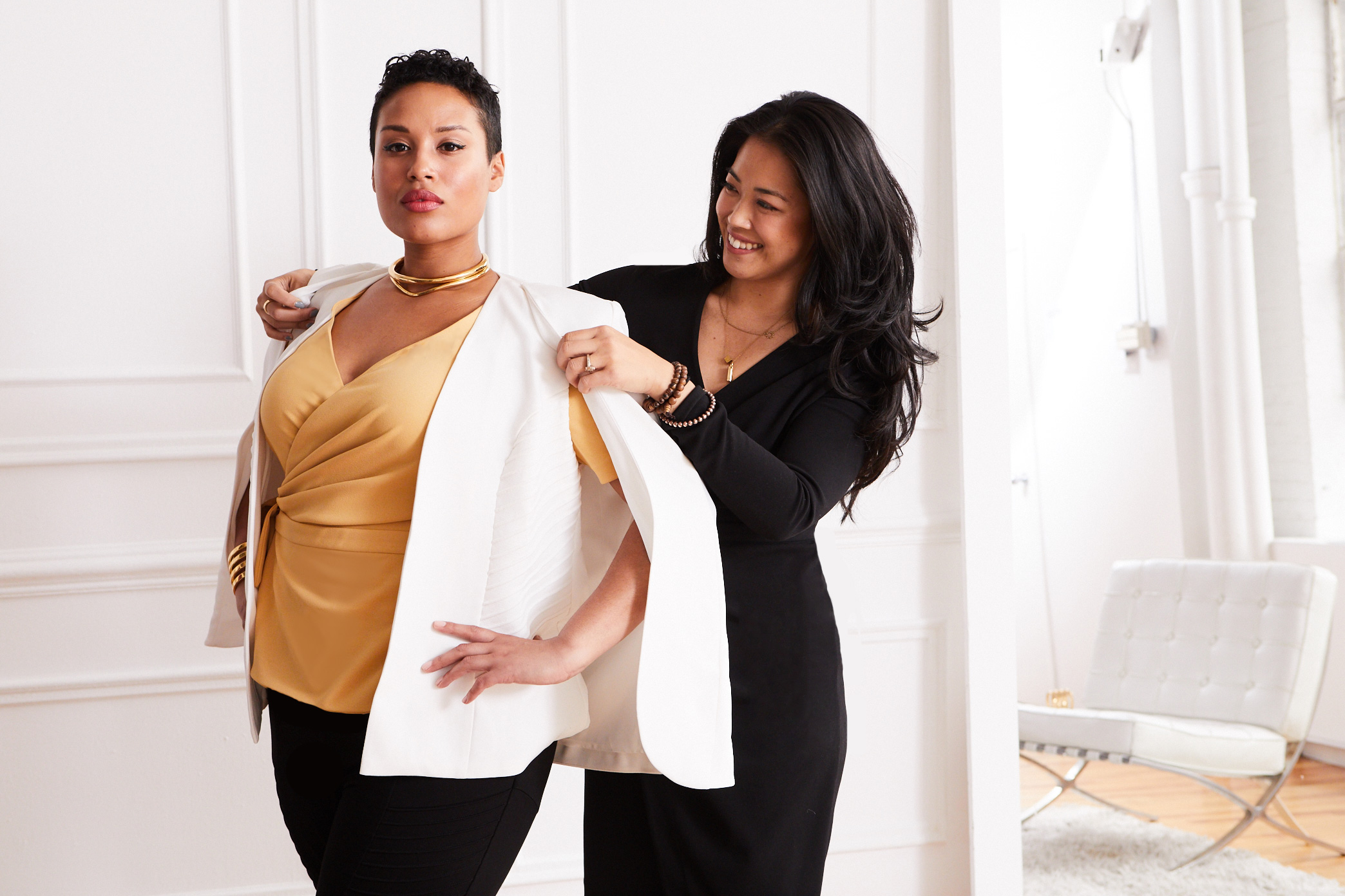 Founder Lisa Sun and a model in her collection